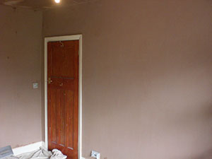 Professional plasterer in Wimbledon SW19. Professionally plastered smooth ceiling in a 2nd bedroom.